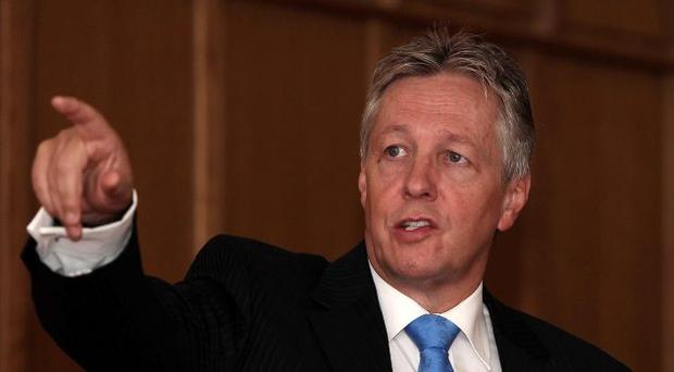 Olive branch: DUP leader Peter Robinson has spoken of improved relations with Tom Elliott and the UUP