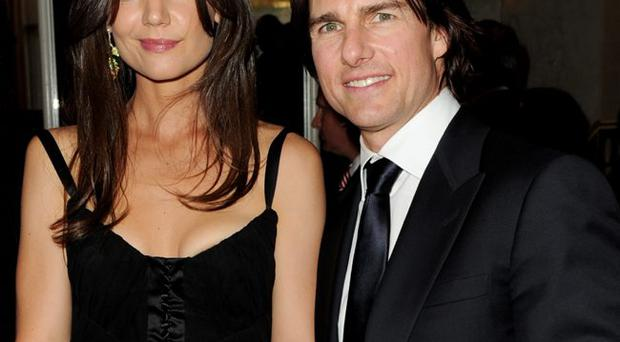 True believers: Tom Cruise and wife Katie Holmes are high profile members of the Church of Scientology