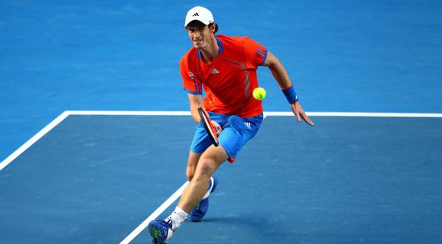 MELBOURNE, AUSTRALIA - JANUARY 19: Andy Murray of Great Britain plays a forehand in his second round match against Edouard Roger-Vasselin of France during day four of the 2012 Australian Open at Melbourne Park on January 19, 2012 in Melbourne, Australia. (Photo by Mark Dadswell/Getty Images)