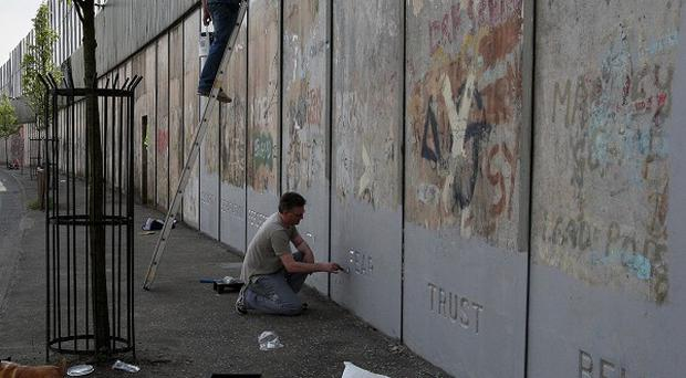 Almost 90 peace walls separate Protestant and Catholic communities across Northern Ireland