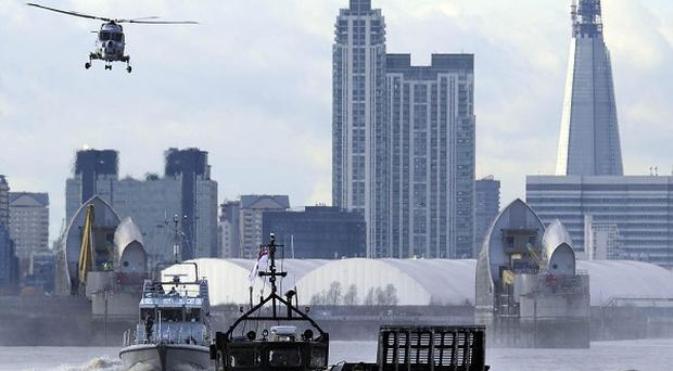 Elite security teams take to the River Thames as part of a massive security rehearsal to foil any terror attack at the Olympics