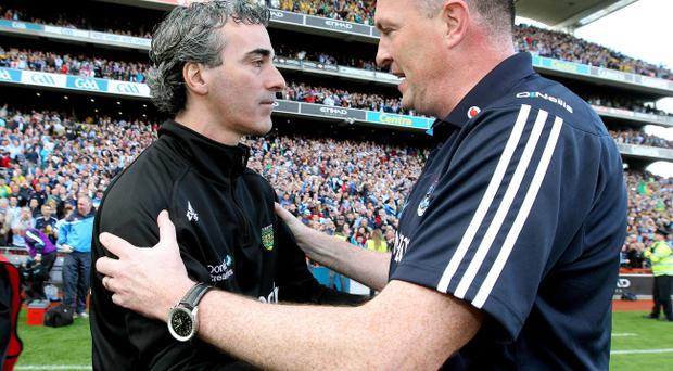 Dublin manager Pat Gilroy (right) speaks to Donegal manager Jim McGuinness after last year's All-Ireland semi-final. Dublin went on to beat Kerry in the final