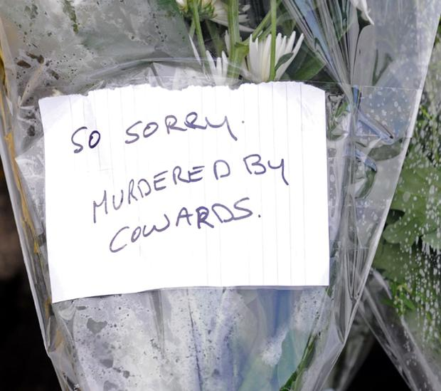 Flowers at the scene of the fatal shootings outside Massereene army base