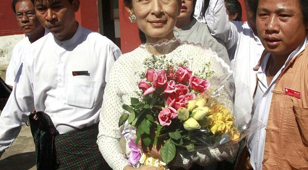 Burma's opposition leader Aung San Suu Kyi has said she will personally contest the country's parliamentary elections on April 1 (AP)
