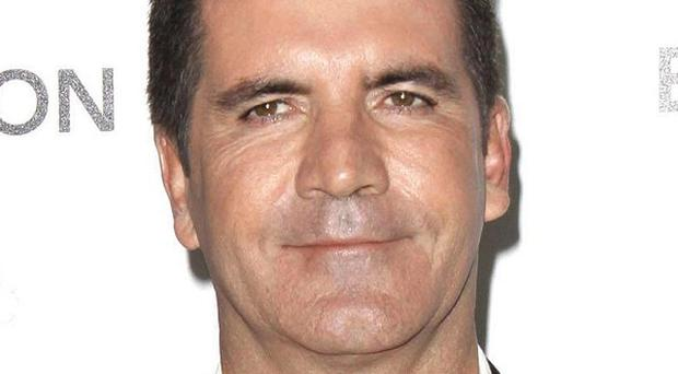 Simon Cowell says his 'ego was put in check' last year
