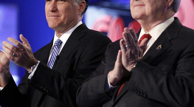 Mitt Romney, left, and Newt Gingrich take the stage before the start of the Republican presidential candidate debate (AP)