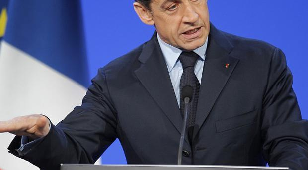 President Nicolas Sarkozy has suspended training programmes for Afghan troops after four French soldiers were killed (AP)