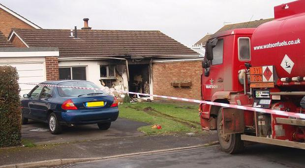 A fuel tanker crashed into a bungalow in Dorset, setting it on fire