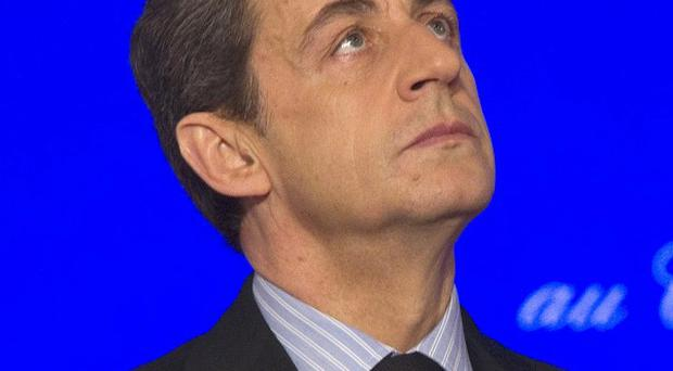 President Nicolas Sarkozy ordered French forces to stop training Afghan forces and suspended joint patrols (AP)