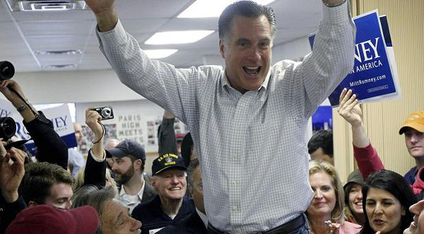 Former Massachusetts governor Mitt Romney campaigns at Tommy's Country Ham House in Greenville, South Carolina (AP)