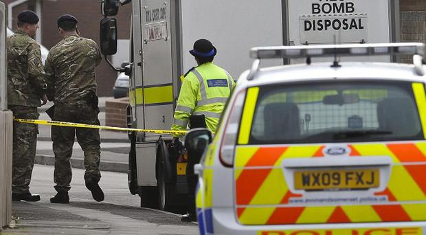 Police and an Army bomb disposal team at the scene on Beatty Way, Burnham on Sea in Somerset on Friday