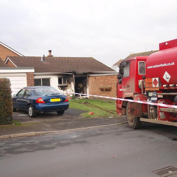 The fuel tanker crashed into the bungalow, setting it on fire (Dorset Fire Service/PA)
