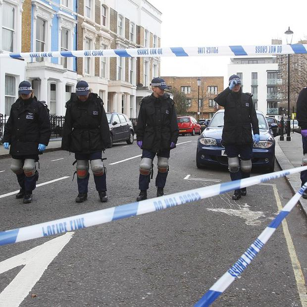 Police attend the scene of a shooting at Westbourne Park, London