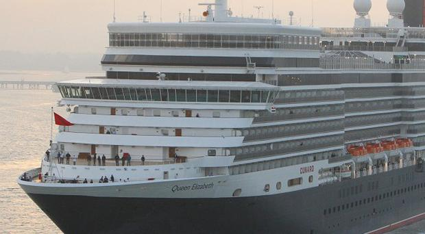 A man is alleged to have sexually abused children onboard the Queen Elizabeth, pictured, and its sister vessel the Queen Mary 2