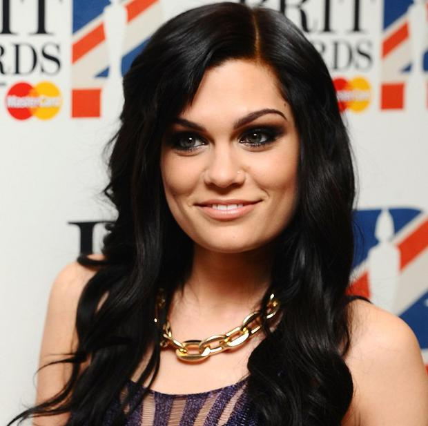 Jessie J remains at the top of the UK singles chart with Domino