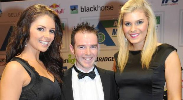 Enkalon Irish Motorcyclist of the Year Alistair Seeley is congratulated by Adelaide girls Clara Anderson and Jacqueline Gracey at the Adelaide Motorcycle Awards in Belfast