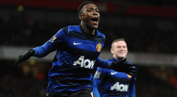 Manchester United's Danny Welbeck (right) celebrates scoring their second goal of the game during the Barclays Premier League match at the Emirates Stadium, London
