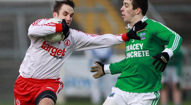 Tyrone's Mark Donnelly holds off Fermanagh's Barry Owens