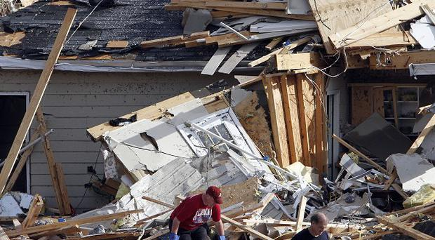 Residents comb through debris after a severe storm in Trussville, Alabama (AP)