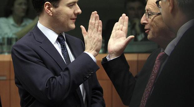George Osborne and Luxembourg's Prime Minister Jean-Claude Juncker (AP Photo/Virginia Mayo)