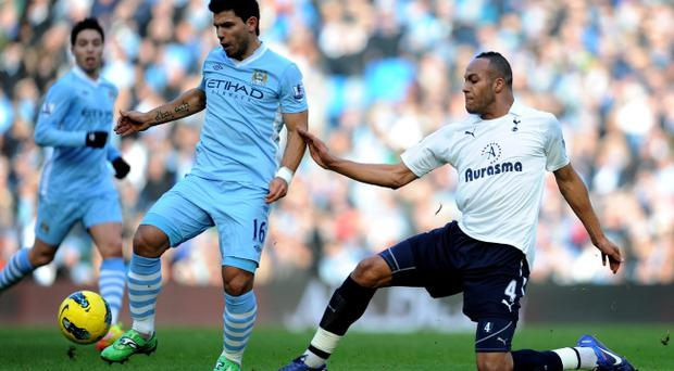 MANCHESTER, ENGLAND - JANUARY 22: Sergio Aguero of Manchester City is challenged by Younes Kaboul of Tottenham Hotspur during the Barclays Premier League match between Manchester City and Tottenham Hotspur at the Etihad Stadium on January 22, 2012 in Manchester, England. (Photo by Michael Regan/Getty Images)