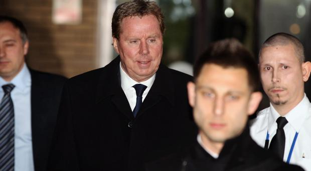 Tottenham Hotspur manager Harry Redknapp, 64, leaves Southwark Crown court on January 23, 2012 in London, England. Mr Redknapp is faces charges of Tax Evasion dating back to between 2002 and 2004, when he was the Portmouth's manager. According to reports payments were made to Mr Redknapp's Monaco bank account in the name of his dog Rosie