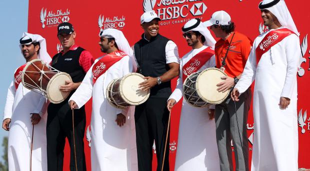 ABU DHABI, UNITED ARAB EMIRATES - JANUARY 24: (L to R) Lee Westwood of England, Tiger Woods of the USA and Rory McIlroy of Northern Ireland pose with a traditional Emirati Al-Ayala dance troupe as a preview for the 2012 Abu Dhabi HSBC Golf Championship at the Abu Dhabi Golf Club on January 24, 2012 in Abu Dhabi, United Arab Emirates. (Photo by Scott Halleran/Getty Images)