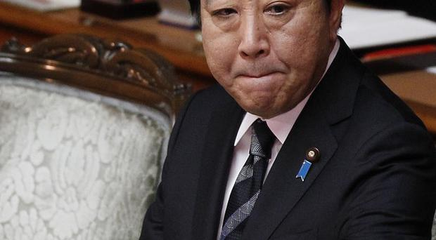 Prime Minister Yoshihiko Noda gets ready to give his policy speech at the Japanese parliament (AP)