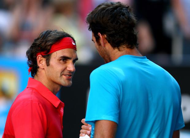 MELBOURNE, AUSTRALIA - JANUARY 24: Roger Federer of Switzerland shakes hands with Juan Martin Del Potro of Argentina after winning match point and his quarter final match during day nine of the 2012 Australian Open at Melbourne Park on January 24, 2012 in Melbourne, Australia. (Photo by Mark Dadswell/Getty Images)