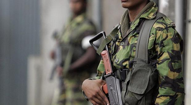 Soldiers were called in after clashes between guards and inmates at a prison in Colombo, Sri Lanka (AP)