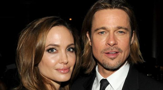 Angelina Jolie and actor Brad Pitt attend the 23rd annual Producers Guild Awards at The Beverly Hilton hotel on January 21, 2012