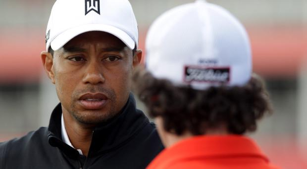 ABU DHABI, UNITED ARAB EMIRATES - JANUARY 24: Tiger Woods of the USA and Rory McIlroy of Northern Ireland during a practice round at the Abu Dhabi Golf Club prior to the Abu Dhabi HSBC Golf Championship on January 24, 2012 in Abu Dhabi, United Arab Emirates. (Photo by Ross Kinnaird/Getty Images)