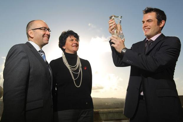 Enterprise Minister Arlene Foster with Ryan Daly, winner of the Northern Bank Young Entrepreneur of the Year Award, and Kevin Kingston, MD Business & Corporate Banking, Northern Bank. Ryan, 29, started his company Daly Renewables in August 2010. The Lisburn company designs, installs, commissions and provides maintenance for bespoke under floor heating and renewable energy systems.