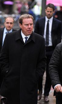 Tottenham Hotspur manager Harry Redknapp, followed by his son Jamie (background, right), arrives at Southwark Crown Court, London, today where he is on trial accused of tax evasion