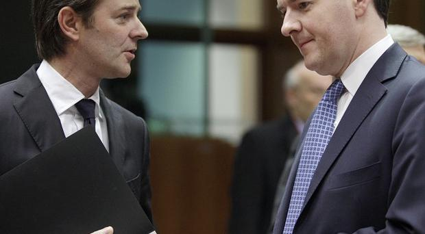 French finance minister Francois Baroin speaks to Chancellor George Osborne during a meeting in Brussels (AP)