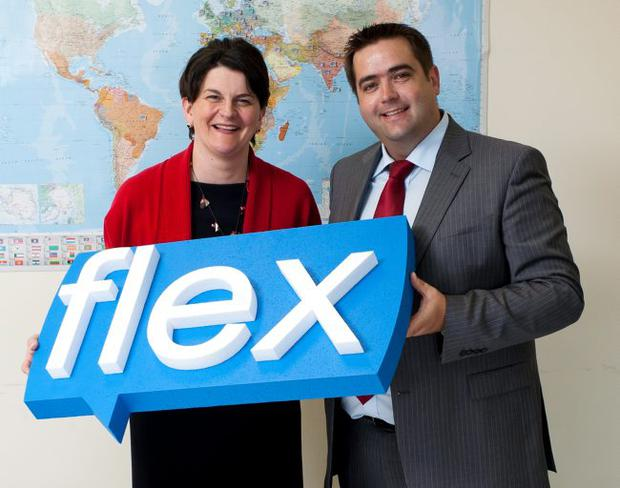 Ortus Chief Executive Seamus O'Prey and Enterprise Minister Arlene Foster celebrate the Acquisition of Flex Language Services by Ortus