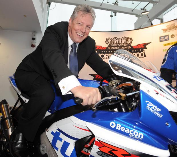 PACEMAKER, BELFAST, 24/1/2012: First Minister Peter Robinson tries Alistair Seeley's Tyco Suzuki for size at the launch of the 2012 Relentless North West 200 at the Waterfront Hall, Belfast