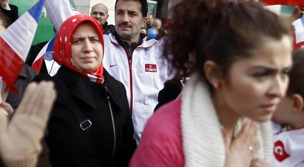 Turkish citizens demonstrate in front of the Senate in Paris (AP)