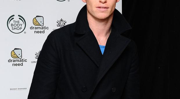 Eddie Redmayne is hoping his singing will be up to scratch for Les Mis