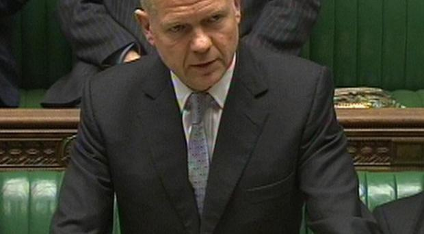 Foreign Secretary William Hague has told MPs that he hopes Iran will engage in talks after oil sanctions were imposed