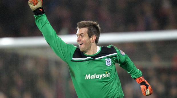 Cardiff City goalkeeper Tom Heaton celebrates victory in the penalty shoot-out during the Carling Cup, Semi Final, Second Leg match at Cardiff City Stadium, Cardiff