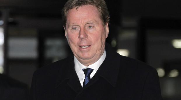 Tottenham Hotspur soccer club manager Harry Redknapp leaves the Southwark Crown Court in London, following a trial on tax evasion charges, Tuesday, Jan. 24, 2012