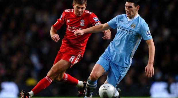 Gareth Barry (right) turned down a move to Liverpool in favour of Manchester City. Tonight he will face the Anfield club's captain Steven Gerrard in the second-leg of the Carling Cup semi-final