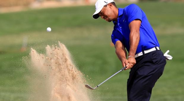 ABU DHABI, UNITED ARAB EMIRATES - JANUARY 25: Tiger Woods of the USA plays a bunker shot during the pro-am for the Abu Dhabi HSBC Championship at the Abu Dhabi Golf Club on January 25, 2012 in Abu Dhabi, United Arab Emirates. (Photo by David Cannon/Getty Images)
