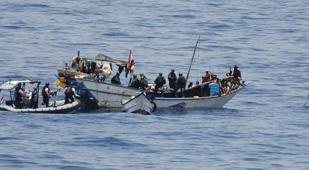 Pirates off the Somali coast trying to capture ships for ransom - US Special Forces have freed two of their hostages (AP)