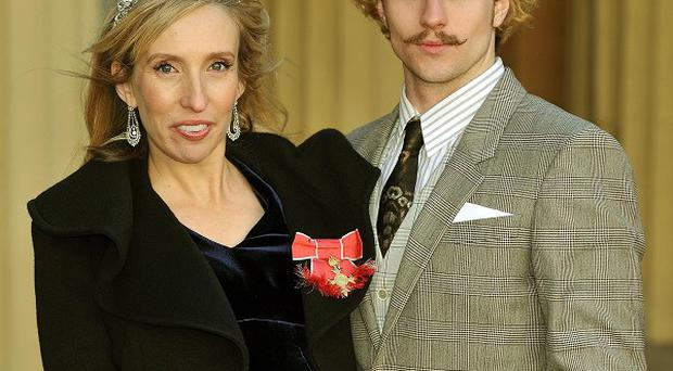 Sam Taylor-Wood was heavily pregnant when she collected her OBE with Aaron Johnson