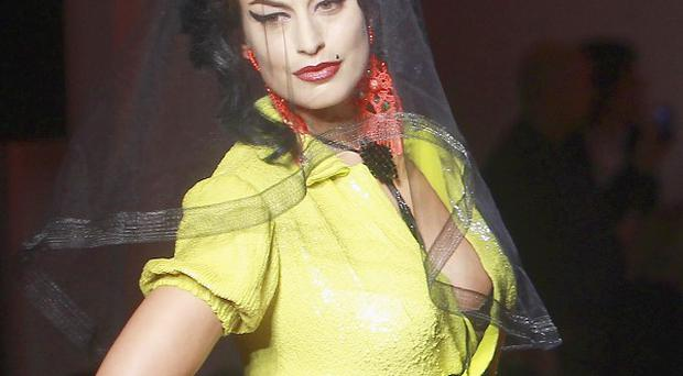 A model wears one of the Amy Winehouse-inspired creations of Jean Paul Gaultier