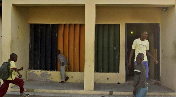 Residents view the police station that was attacked in the Sheka in Kano, Nigeria (AP Photo/Sunday Alamba)