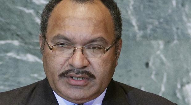 Rebel soldiers have given Papua New Guinea's prime minister Peter O'Neill a week to step aside (AP)