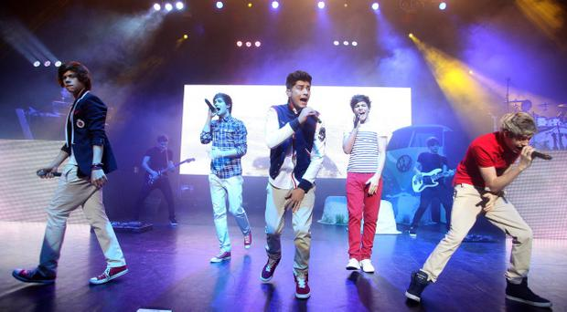 X Factor 2011 contestants, One Direction peforming in the Waterfront Hall, Belfast. January 25 2012. Pic David Fitzgerald